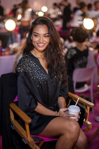 (Photo by Charles Sykes/Invision/AP). Shanina Shaik appears backstage during hair and makeup at the 2018 Victoria's Secret Fashion Show at Pier 94 on Thursday, Nov. 8, 2018, in New York.