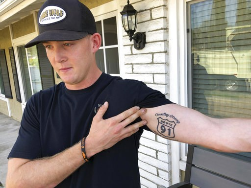 (AP Photo/Ryan Pearson). Brendan Kelly speaks with reporters outside his home, as he shows his Route 91 tattoo, Thursday, Nov. 8, 2018, in Thousand Oaks, Calif. Kelly, a Marine who was at Borderline Bar and Grill on Wednesday night, helped people get o...