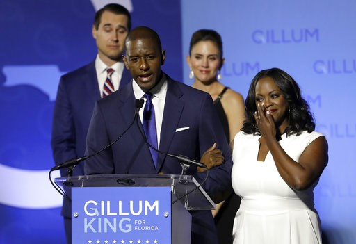 (AP Photo/Chris O'Meara). Florida Democratic gubernatorial candidate Andrew Gillum gives his concession speech as he is joined on stage by his wife R. Jai Gillum, right, and running mate Chris King and his wife Kristen Tuesday, Nov. 6, 2018, in Tallaha...