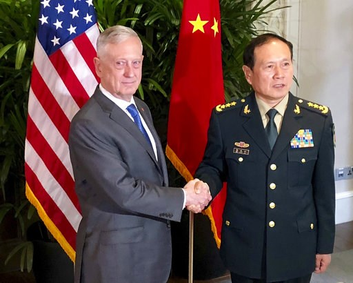 (AP Photo/Robert Burns, File). FILE - In this Thursday, Oct. 18, 2018, file photo, U.S. Defense Secretary Jim Mattis, left, meets Chinese Defense Minister Wei Fenghe in Singapore. Mattis and Secretary of State Mike Pompeo will meet Friday, Nov. 9 with ...