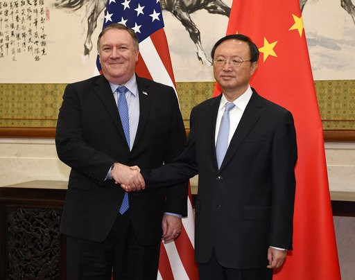 (Daisuke Suzuki/Pool Photo via AP, File). FILE - In this Monday, Oct. 8, 2018, file photo, U.S. Secretary of State Mike Pompeo, left, shakes hands with Yang Jiechi, a member of the Political Bureau of the Chinese Communist Party, before a meeting at th...