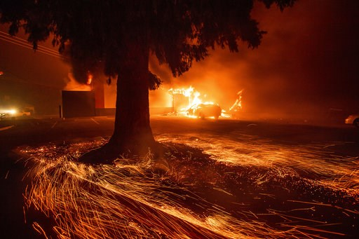 (AP Photo/Noah Berger). Flames consume a Kentucky Fried Chicken as the Camp Fire tears through Paradise, Calif., on Thursday, Nov. 8, 2018. Tens of thousands of people fled a fast-moving wildfire Thursday in Northern California, some clutching babies a...
