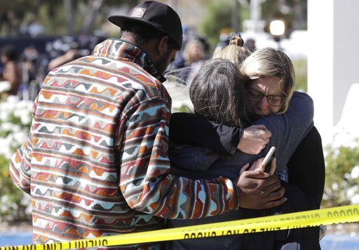 (AP Photo/Marcio Jose Sanchez). Mourners embrace outside of the Thousand Oaks Teen Center, where relatives and friends gathered in the aftermath of a mass shooting, Thursday, Nov. 8, 2018, in Thousand Oaks, Calif. Multiple people were shot and killed l...