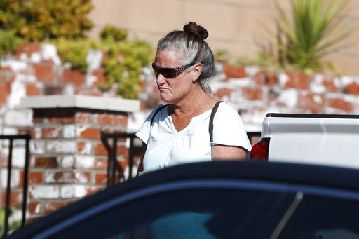 (AP Photo/Jae C. Hong). Colleen Long, mother of shooting suspect David Ian Long, leaves her house in Newbury Park, Calif., on Thursday, Nov. 8, 2018. Authorities said the former Marine opened fire at a country music bar in Southern California on Wednes...