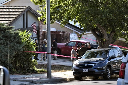 (AP Photo/Richard Vogel). Ventura County Sheriff's deputies and FBI investigators stand outside the house of shooting suspect David Ian Long in Newbury Park, Calif., on Thursday, Nov. 8, 2018. Authorities said the former Marine opened fire at a country...