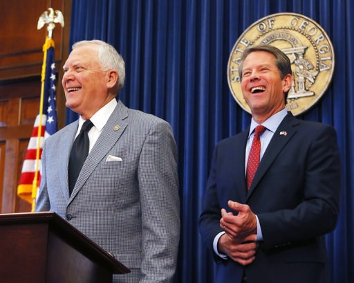 (Bob Andres/Atlanta Journal-Constitution via AP). Republican Brian Kemp, right, and Georgia Gov. Nathan Deal hold a news conference in the Governor's ceremonial office at the Capitol on Thursday, Nov. 8, 2018, in Atlanta, Ga. Kemp resigned Thursday as ...