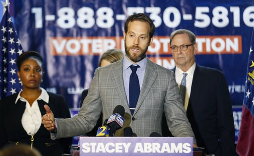 (Bob Andres/Atlanta Journal-Constitution via AP). Kurt Kastorf, one of Stacey Abrams' attorneys, speaks during a news conference Thursday, Nov. 8, 2018, in Atlanta. Republican Brian Kemp resigned Thursday as Georgia's secretary of state, a day after hi...