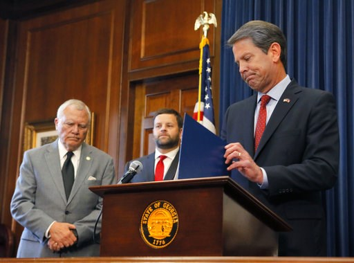 (Bob Andres/Atlanta Journal-Constitution via AP). Republican Brian Kemp, right, holds a news conference with Georgia Gov. Nathan Deal, left, in the Governor's ceremonial office at the Capitol on Thursday, Nov. 8, 2018, in Atlanta, Ga. Kemp resigned Thu...