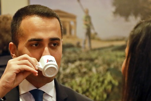 (AP Photo/Andrew Medichini). Deputy Premier and Labor Minister Luigi Di Maio enjoys a coffee as he arrives for a press conference at the Foreign Press Association headquarters, in Rome, Friday, Nov. 9, 2018.