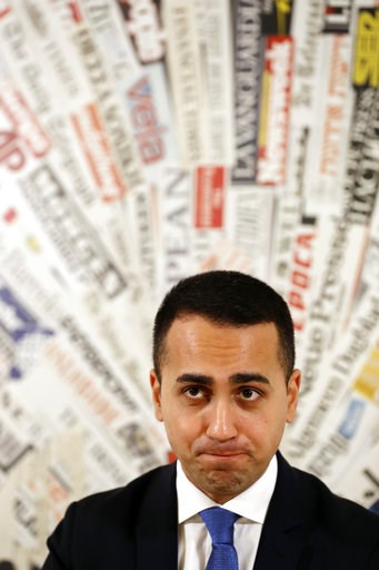 (AP Photo/Andrew Medichini). Deputy Premier and Labor Minister Luigi Di Maio listens to reporters' questions during a press conference at the Foreign Press Association headquarters, in Rome, Friday, Nov. 9, 2018.