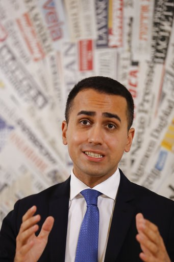(AP Photo/Andrew Medichini). Deputy Premier and Labor Minister Luigi Di Maio talks to reporters during a press conference at the Foreign Press Association headquarters, in Rome, Friday, Nov. 9, 2018.