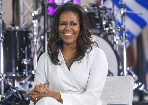 """(Photo by Charles Sykes/Invision/AP, File). FILE - In this Oct. 11, 2018, file photo, Michelle Obama participates in the International Day of the Girl on NBC's """"Today"""" show in New York."""