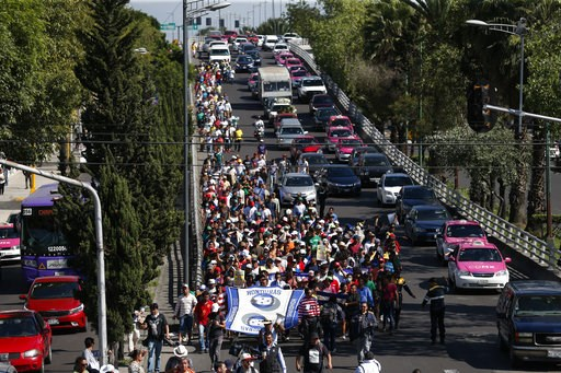 (AP Photo/Rebecca Blackwell). A group of Central American migrants, representing the thousands participating in a caravan trying to reach the U.S. border, undertake an hours-long march to the office of the United Nations' humans rights body in Mexico C...