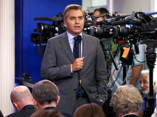(AP Photo/Evan Vucci, File). FILE - In this Aug. 2, 2018 file photo, CNN correspondent Jim Acosta does a stand up before the daily press briefing at the White House in Washington. The White House on Wednesday suspended the press pass of CNN corresponde...