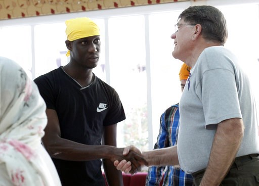 (AP Photo/Amanda Loman). In this Wednesday, Oct. 3, 2018, photo, Dan McCracken, right, a volunteer with Innovation Law Lab, says goodbye to Abdoulaye Camara, an immigrant from Mauritania, at the Dasmesh Darbar Sikh temple in Salem, Ore. Camara was one ...