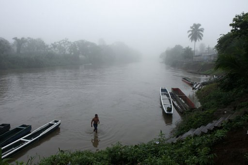 (AP Photo/Arnulfo Franco, File). FILE - In this June 22, 2012, file photo, a man bathes in a river at dawn in the Darien Province on the border with Colombia, in Union Choco, Panama. The area is known as the Darien Gap, a 60-mile (97-kilometer) stretch...