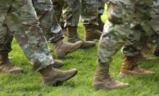 (AP Photo/Ted S. Warren, File). FILE- In this April 3, 2017, file photo U.S. Army soldiers march in formation during a change of command ceremony at Joint Base Lewis-McChord in Washington. If you're a veteran with student debt, you have repayment right...
