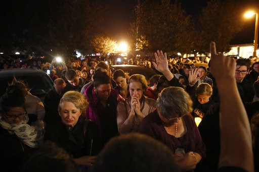 (AP Photo/Jae C. Hong). People gather outside the Rivalry Roasters coffee shop for a vigil for Sean Adler Thursday, Nov. 8, 2018, in Simi Valley, Calif. Adler was killed in Wednesday night's shooting at the Borderline Bar and Grill in Thousand Oaks, Ca...
