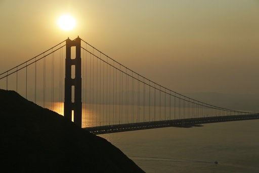 (AP Photo/Eric Risberg). Smoke from wildfires obscures the San Francisco skyline behind the Golden Gate Bridge Friday, Nov. 9, 2018, near Sausalito, Calif. A California fire official says a blaze in Northern California nearly quadrupled in size overnig...