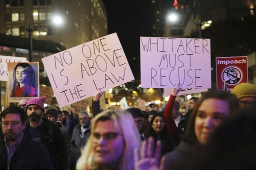(Genna Martin/seattlepi.com via AP). Protesters march from Cal Anderson Park to the Federal Building downtown in Seattle, in support of special counsel Robert Mueller and against President Donald Trump's appointment this week of acting Attorney General...