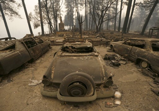(AP Photo/Rich Pedroncelli). Three cars destroyed by a wildfire sit at a burned out home Friday, Nov. 9, 2018, in Paradise, Calif. Authorities have confirmed that at least six people have died in the fire that has consumed more than 70,000 acres and de...