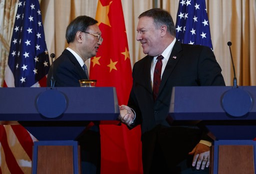 (AP Photo/Carolyn Kaster). Secretary of State Mike Pompeo, right, shakes hands with Chinese Politburo Member Yang Jiechi at the conclusion of a news conference at the State Department in Washington, Friday, Nov. 9, 2018.