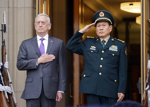 (AP Photo/Pablo Martinez Monsivais). Defense Secretary Jim Mattis and Chinese Minister of Defense General Wei Fenghe, stand as the national anthems are played during an welcome ceremony at the Pentagon, Friday, Nov. 9, 2018.