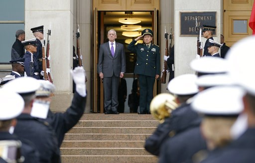 (AP Photo/Pablo Martinez Monsivais). Defense Secretary Jim Mattis and Chinese Minister of Defense General Wei Fenghe, stand as the national anthems are played during an enhanced honor cordon at the Pentagon, Friday, Nov. 9, 2018.