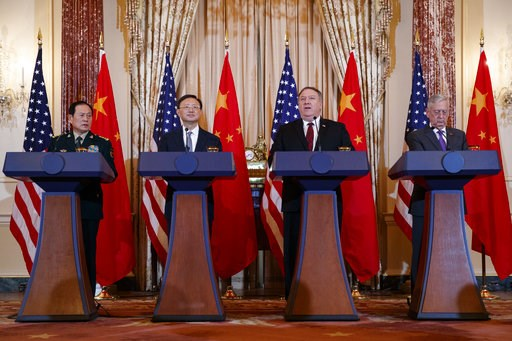 (AP Photo/Carolyn Kaster). From left, Chinese State Councilor and Defense Minister General Wei Fenghe, Chinese Politburo Member Yang Jiechi, Secretary of State Mike Pompeo, and Secretary of Defense Jim Mattis, participate in a news conference at the St...