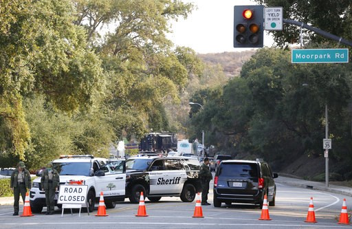 (AP Photo/Damian Dovarganes). Police block the entrance to the parking lot leading to the Borderline Bar & Grill in Thousand Oaks, Calif., Thursday, Nov. 8, 2018. A gunman opened fire Wednesday evening inside a country music bar, killing multiple p...
