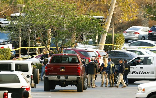 (AP Photo/Damian Dovarganes). FBI investigators join law enforcement as they work near the scene of Wednesday's shooting in Thousand Oaks, Calif., Friday, Nov. 9, 2018. Investigators continue to work to figure out why an ex-Marine opened fire Wednesday...