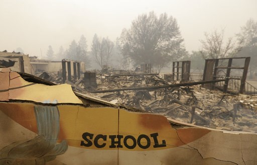 (AP Photo/Rich Pedroncelli). The burned remains of the Paradise Elementary school is seen Friday, Nov. 9, 2018, in Paradise, Calif. Blocks and blocks of homes and businesses in the Northern California town have been destroyed by a wildfire. Parts of th...