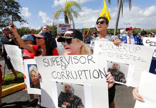 (AP Photo/Joe Skipper). A crowd protests outside the Broward County Supervisor of Elections office Friday, Nov. 9, 2018, in Lauderhill, Fla. A possible recount looms in a tight Florida governor, Senate and agriculture commission race.