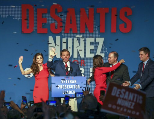 (Chris Urso/Tampa Bay Times via AP). Republican Florida Governor-elect Ron DeSantis, center, waves to the supporters with his wife, Casey, left, and Republican Lt. Governor-elect Jeanette Nunez, third right, after thanking the crowd Tuesday, Nov. 6, 20...