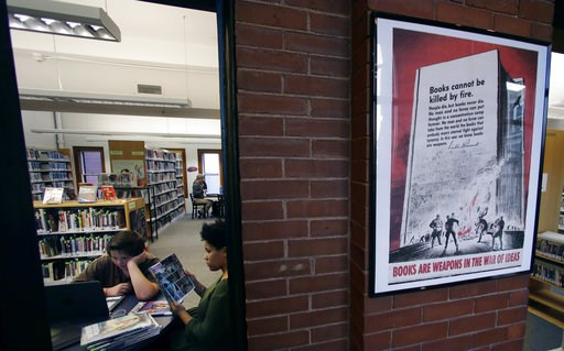 (AP Photo/Charles Krupa). A 1942 Office of War Information poster copy hangs in a hallway of the Rochester Public Library in Rochester, N.H., Thursday, Nov. 8, 2018. A trove of propaganda posters from World War I and II were found recently found after ...