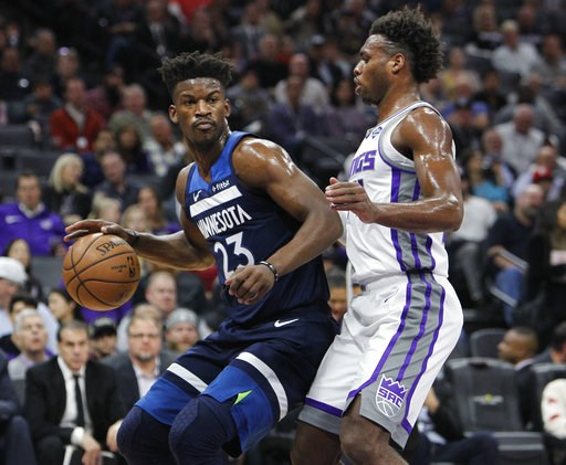 (AP Photo/Steve Yeater). Minnesota Timberwolves guard Jimmy Butler (23) battles for position against Sacramento Kings guard Buddy Hield (24) during the first half of an NBA basketball game in Sacramento, Calif., Friday, Nov. 9, 2018.