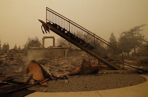 (AP Photo/Rich Pedroncelli). A staircase that once led to another level is seen among the burned remains of home Friday, Nov. 9, 2018, that was destroyed by a wildfire that swept through the area Thursday, in Paradise, Calif.