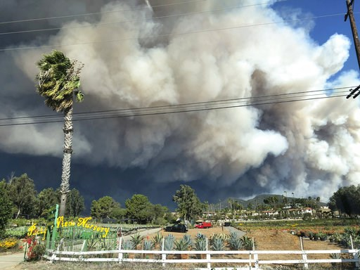 (Courtesy of Ben Watkins via AP). In this Friday, Nov. 9, 2018 photo, smoke from the wildires fills the air in Malibu, Calif.  Los Angeles County fire Chief Daryl Osby said Saturday that firefighters told him they were working in the toughest, most ext...