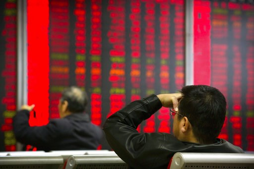 (AP Photo/Mark Schiefelbein). In this Oct. 31, 2018, photo, Chinese investors monitor stock prices at a brokerage house in Beijing. China's government is trying to dispel stock market gloom and talk prices back up with promises of tax cuts and a media ...