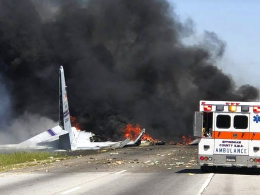 (James Lavine via AP, File). FILE - In this Wednesday, May 2, 2018 file photo, flames and smoke rise from an Air National Guard C-130 cargo plane after it crashed near Savannah, Ga. Investigators say the cause of the military plane crash that left nine...