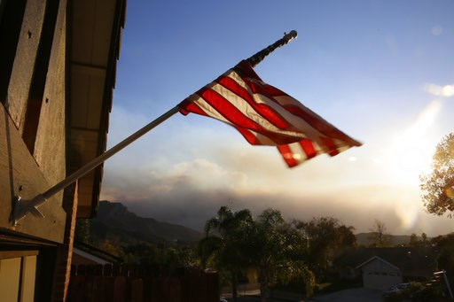 (AP Photo/Damian Dovarganes). A flag is seen partially wrapped up in its pole due to heavy winds, outside the home of the ex-Marine Ian David Long, who killed 12 people at a country music bar Wednesday, in Newbury Park, Calif., Friday, Nov. 9, 2018. Wi...