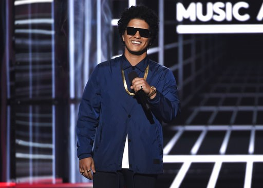 "(Photo by Chris Pizzello/Invision/AP, File). FILE - In this May 20, 2018, file photo, Bruno Mars presents the Icon award at the Billboard Music Awards at the MGM Grand Garden Arena in Las Vegas. Mars will mark the end of his massive ""24K Magic World To..."