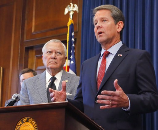 (Bob Andres/Atlanta Journal-Constitution via AP). Republican Brian Kemp, right, speaks during a news conference as Georgia Gov. Nathan Deal listens in the Governor's ceremonial office at the Capitol on Thursday, Nov. 8, 2018, in Atlanta, Ga. Kemp resig...