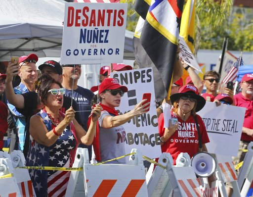 (Carl Juste/Miami Herald via AP). Crowd of protestors gather outside the Broward County of Supervisor of Elections Office as the statewide election recount is underway while ballots for governor, Senate, Agricultural Commission were run through scannin...