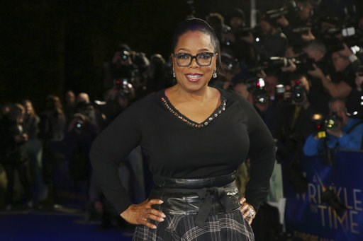 "(Photo by Joel C Ryan/Invision/AP, File). FILE - In this March 13, 2018, file photo, actress Oprah Winfrey poses for photographers upon arrival at the premiere of the film 'A Wrinkle In Time' in London. Winfrey has chosen Michelle Obama's ""Becoming"" as..."