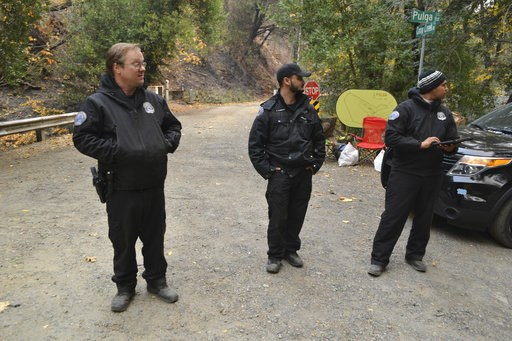 (AP Photo/Peter Banda). Private security guards block the road in Pulga, Calif., Monday, Nov. 12, 2018, to where investigators were trying to determine how the deadly Camp Fire started in Northern California that destroyed the town of Paradise. With th...