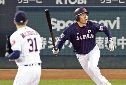 (Kyodo News via AP). All Japan's Shogo Akiyama, right, hits an inside-the-park home run off MLB All-Star pitcher Collin McHugh (31) of the Houston Astros in the eighth inning of Game 4 at their All-Stars Series baseball at Mazda Zoom-Zoom Stadium in Hi...