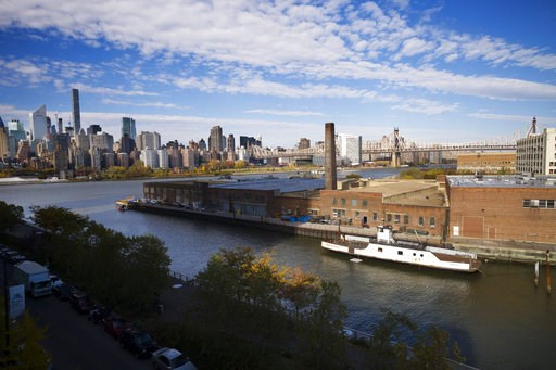 (AP Photo/Mark Lennihan). In this Wednesday, Nov. 7, 2018, photo, a rusting ferryboat is docked next to an aging industrial warehouse on Long Island City's Anable Basin in the Queens borough of New York. Across the East River is midtown Manhattan, top ...