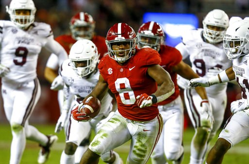 (AP Photo/Butch Dill). Alabama running back Josh Jacobs (8) carries the ball during the second half of an NCAA college football game against Mississippi State, Saturday, Nov. 10, 2018, in Tuscaloosa, Ala.
