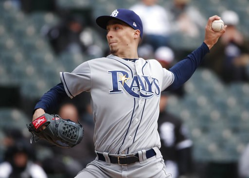 (AP Photo/Jeff Haynes, File). FILE - In this April 10, 2018, file photo, Tampa Bay Rays starting pitcher Blake Snell delivers during the third inning of a baseball game against the Chicago White Sox in Chicago. Snell was announced as the winner of the ...